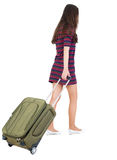 Back view of walking  woman  with green suitcase. Beautiful brunette girl in motion.  backside view of person.  Rear view people collection. Isolated over Stock Photography