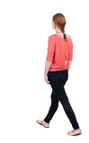 Back view of walking  woman in jeans. beautiful blonde girl in m Stock Photos