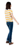 Back view of walking  woman in jeans . Stock Images