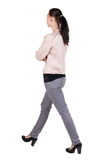 Back view of walking  woman in jeans Stock Photography