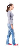 Back view of walking  woman in jeans Royalty Free Stock Photography