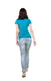 Back view of walking  woman in jeans . Royalty Free Stock Images
