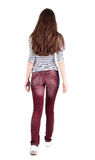 Back view of walking  woman in jeans . Royalty Free Stock Photography