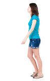 Back view of walking  woman in shorts. Royalty Free Stock Photos