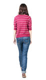 Back view of walking  woman in striped sweater. Stock Images