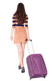 Back view of walking  woman  with suitcase Royalty Free Stock Image