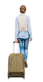 Back view of walking  woman  with suitcase. beautiful girl in mo Royalty Free Stock Photos