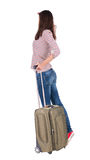 Back view of walking  woman  with suitcase. Stock Image