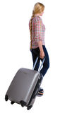 Back view of walking woman with suitcase. Beautiful girl in motion. backside view of person. Rear view people collection. Isolated over white background. Long stock images