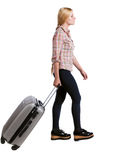 Back view of walking  woman  with suitcase. beautiful girl in motion. Royalty Free Stock Photos