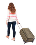 Back view of walking  woman  with suitcase Stock Images