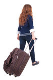 Back view of walking  woman  with suitcase Stock Photography