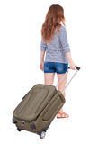 Back view of walking  woman  with suitcase Stock Photos