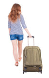 Back view of walking  woman  with suitcase Royalty Free Stock Photos