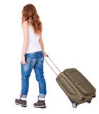 Back view of walking  woman  with suitcase Stock Image