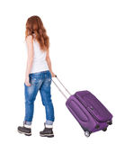 Back view of walking  woman  with suitcase Royalty Free Stock Images