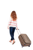 Back view of walking  woman  with suitcase. Royalty Free Stock Photos
