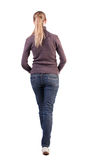 Back view of walking  woman  in  sweater. Beautiful blonde girl in motion.  backside view of person.  Rear view people collection. Isolated over white Stock Photos