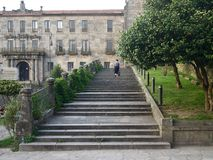 Back view of walking woman tourist on stone stair royalty free stock photo