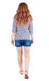 Back view of walking young beautiful  redhead woman Stock Photo