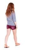 Back view of walking young beautiful  redhead woman Royalty Free Stock Photo
