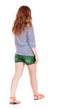Back view of walking young beautiful  redhead woman Stock Image