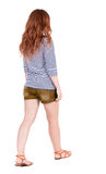Back view of walking young beautiful  redhead woman Stock Photography