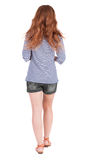 Back view of walking young beautiful  redhead woman Royalty Free Stock Photos