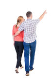 Back view of walking young couple (man and woman) pointing. Stock Photography