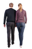 Back view of walking young couple stock photos