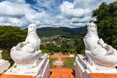 Back view of white lion statue at Wat Phra That Doi Kong Mu with Stock Photo