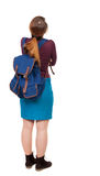 Back view of  woman with backpack looking up. Stock Image