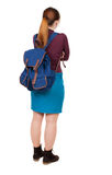 Back view of  woman with backpack looking up. Stock Photos