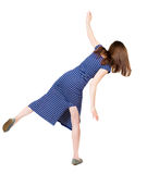 Back view woman Balances waving his arms. Royalty Free Stock Image