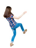 Back view woman Balances waving his arms.   Standing young girl Stock Images