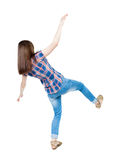 Back view woman Balances waving his arms.   Standing young girl Royalty Free Stock Photos