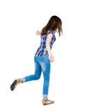 Back view woman Balances waving his arms.   Standing young girl Stock Photos