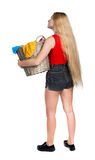 Back view of woman with  basket  dirty laundry. girl is engaged in washing. Stock Photo