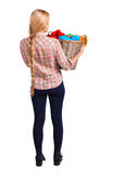 Back view of woman with  basket  dirty laundry. girl is engaged in washing. Royalty Free Stock Photography