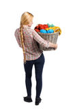 Back view of woman with  basket  dirty laundry. girl is engaged in washing. Stock Images
