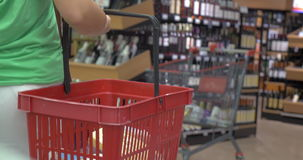 Back view of woman with basket in shop stock video footage