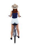 Back view of a woman with a bicycle. Royalty Free Stock Image