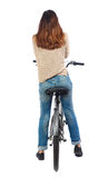 Back view of a woman with a bicycle. Stock Photos