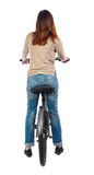 Back view of a woman with a bicycle. Royalty Free Stock Photos