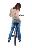 Back view of a woman with a bicycle. Stock Images