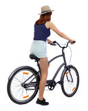 Back view of a woman with a bicycle. Royalty Free Stock Photography