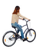 Back view of a woman with a bicycle Stock Image
