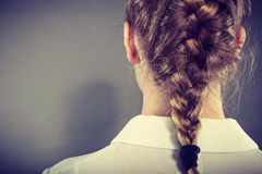 Back view of woman with blonde braid. Stock Photos