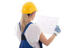 Back view of woman in blue builder uniform holding building proj Stock Images