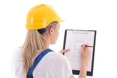 Back view of woman in blue builder uniform holding building sche. Me isolated on white background Stock Photos